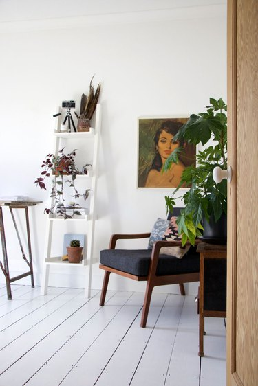 Feng Shui Home Office with minimal decor, plants, and painting