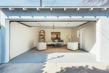 Garage Organization Tips and Tricks in white garage with jute rug
