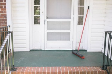 Concrete porch swept clean with a broom