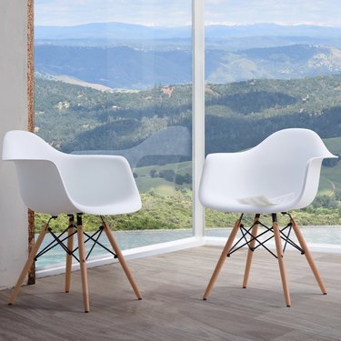 Set of two white Eames-inspired dining chairs with arms
