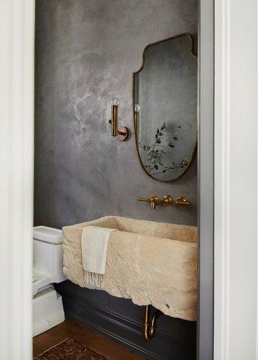 industrial bathroom backsplash with stone sink