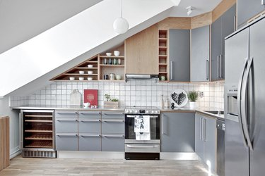contemporary kitchen with stainless steel countertops and cabinet fronts