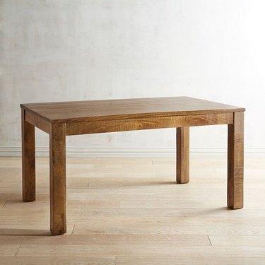Rectangular wooden dining table in blonde-medium finish