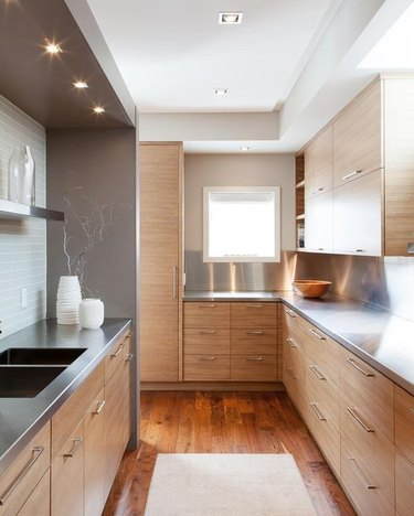 light wood kitchen with stainless steel countertops