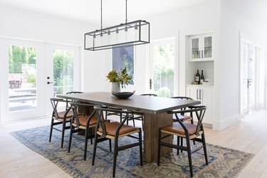 dining room with dark table and glass doors