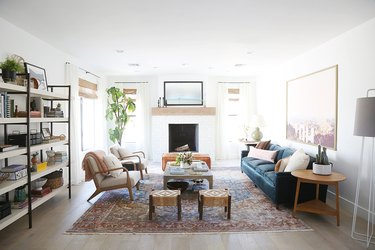 white living room with a subtle tile pattern over the fireplace