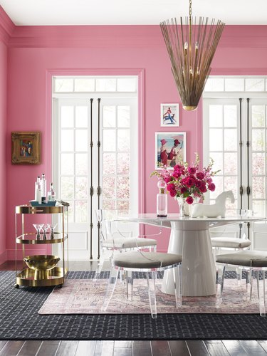 dining room area with bright pink wall