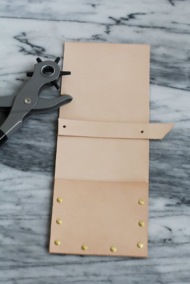 Punching two holes on leather strip