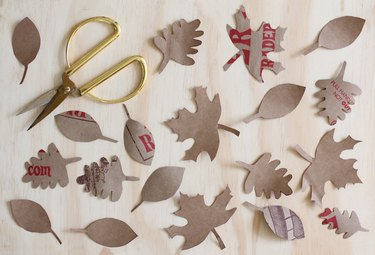 Leaf shapes cut out of recycled paper bag
