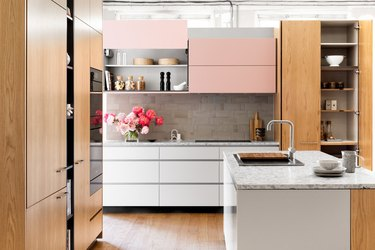 kitchen cabinet style with flat front cabinets in wood, pink, and white