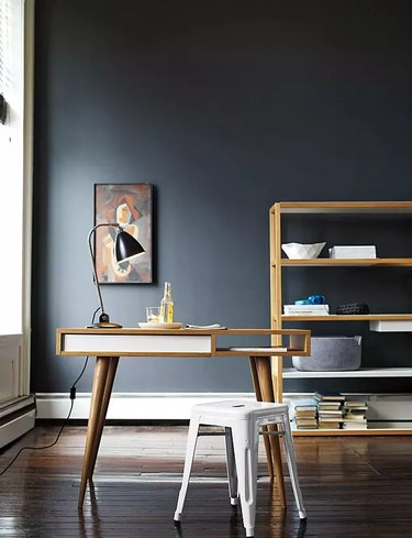 Feng Shui Home Office with midcentury desk and dark wall
