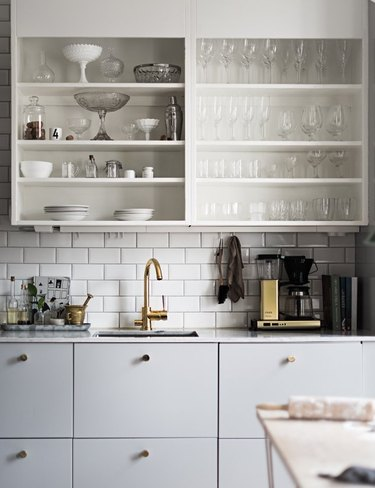 small kitchen design with gray cabinets and open shelving with subway tile backsplash