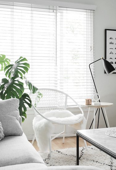 white living room with black accents and area rug