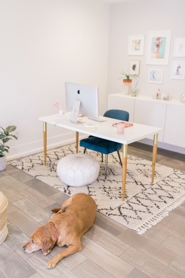 Feng Shui Home Office in boho glam home office with patterned rug and green chair