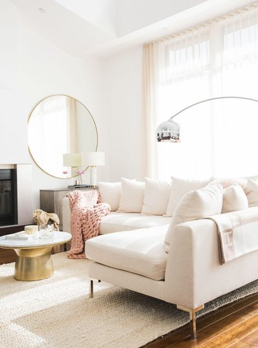 white living room with sectional sofa and high ceilings
