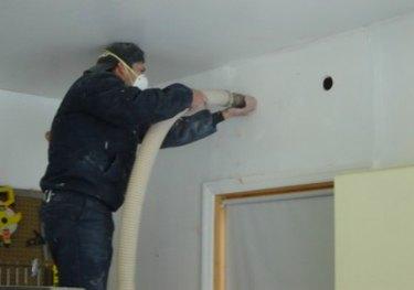 Installing loose fill behind walls.