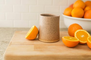 tumbler with oranges nearby