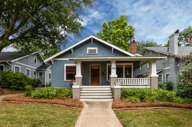 craftsman house with white steps and blue exterior