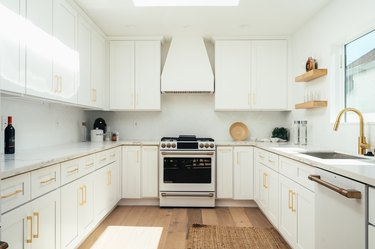 white kitchen with gold cabinet hardware
