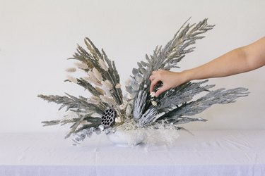 Placing sola flowers into vase