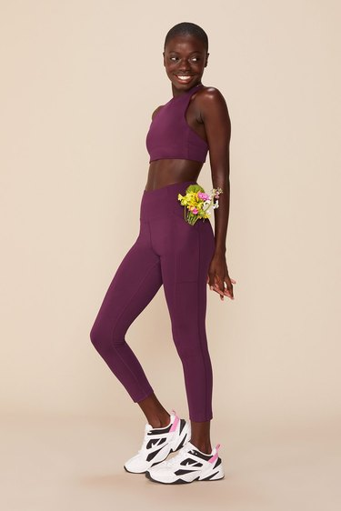 girlfriend collective legging and bra set in plum color