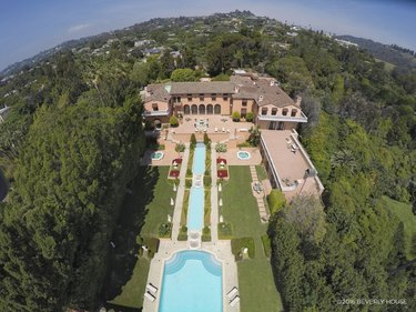 aerial view of mansion with pool