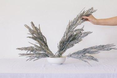 Adding pampas grass to vase