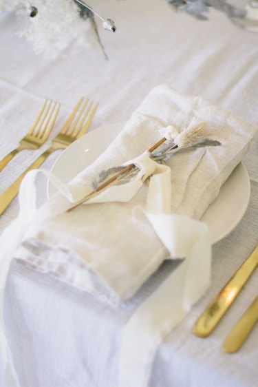 Flowers tied with ribbon on place setting