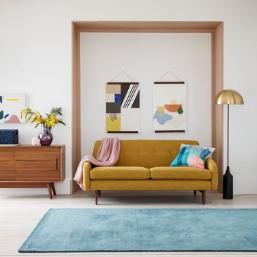 West Elm Pascale mustard sofa with wood legs
