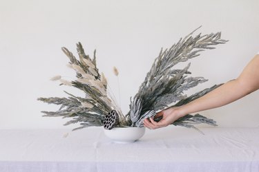 Placing protea flowers into vase