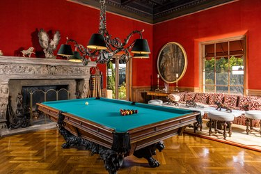 billiards room with red walls