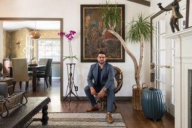 Homeowner Adam Kawalek sits in his Los Angeles home