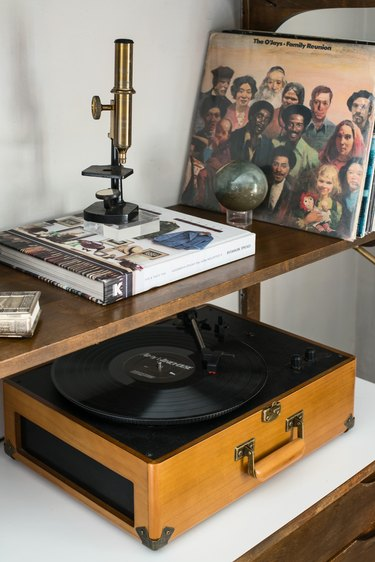 A microscope, record player, and records in Kawalek and Navarro's home