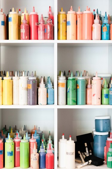 paints in shelves