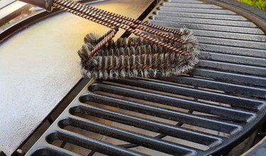 Cleaning a cast iron grate.