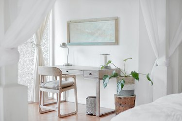white home office idea with desk, chair, and plant