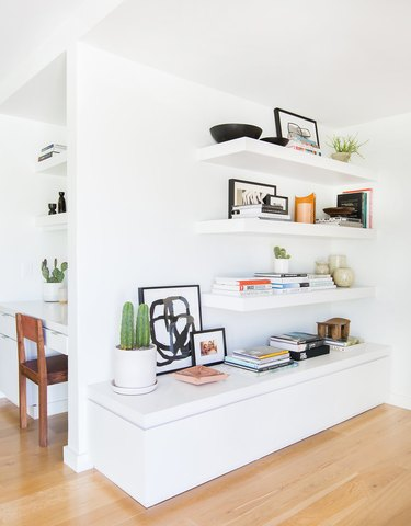 midcentury modern hallway with built in shelves