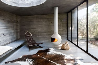 white hanging fireplace with cowhide rug