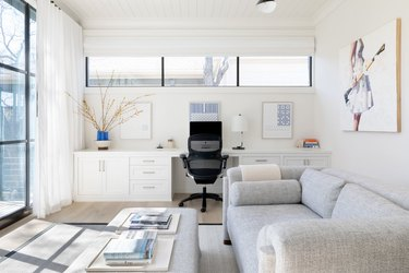 white home office idea with couch and large windows