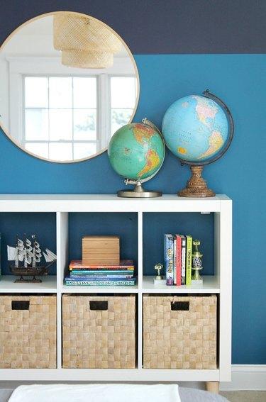 Stripes of blue accent a bookshelf