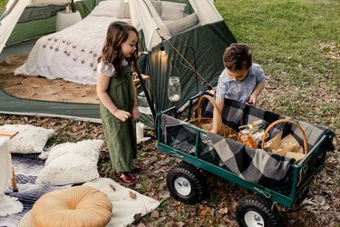 "Kids next to tent camping or ""glamping"""