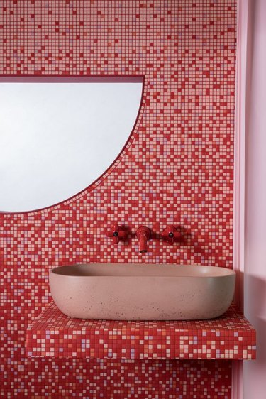 red and pink bathroom with mosaic tiles and tile countertop