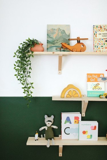 A shelving wall in hunter green and white