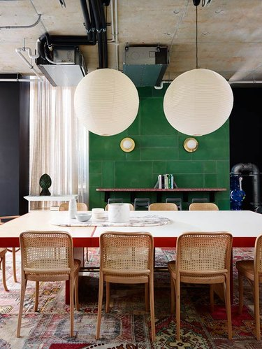 dining space with green tile accent wall
