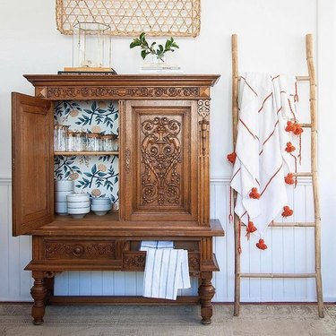 vintage cabinet lined with removable wallpaper