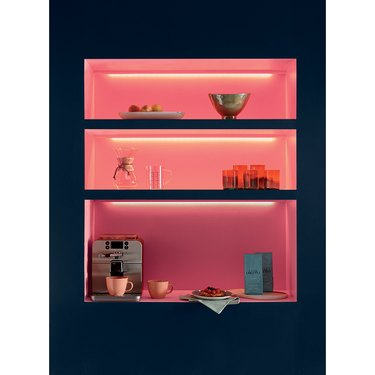 dishes in coral colored shelf