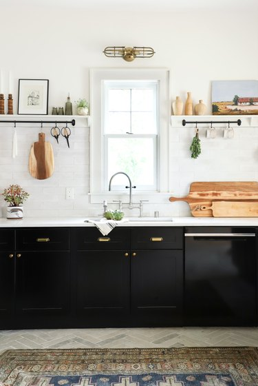 black and white kitchen with brass accents and open shelving