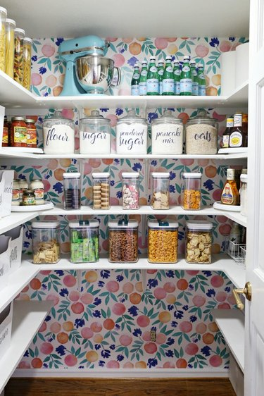 back wall of pantry lined with removable wallpaper