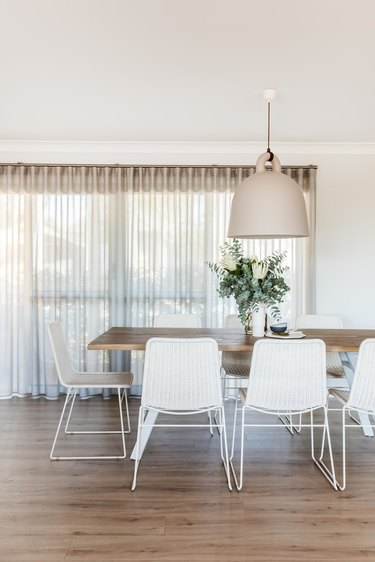 white dining room lighting idea with oversize minimal pendant