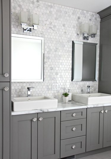 marble laminate bathroom countertops with marble mosaic tile backsplash and gray cabinets